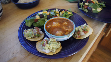 Seviche on tiny tortillas with guacamole and tortilla ball soup and salad